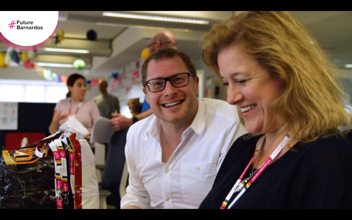 smiling colleagues - screenshot of futurebarnardos video